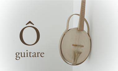 Project visual Ô : une guitare en bois tourné